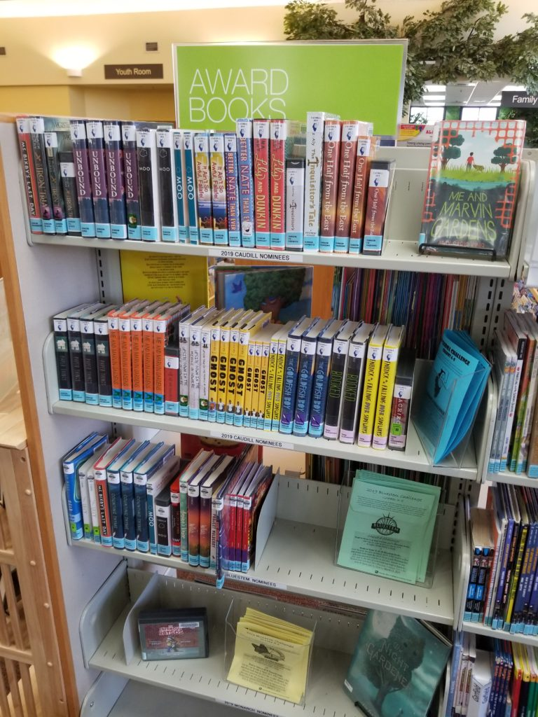 """A series of four shelves, with a sign above reading """"Award Books"""""""